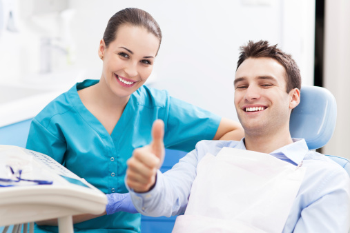 Man giving thumbs up at The Elmwood Dental Group LLC dentist office